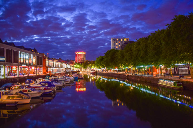 Bristol Quayside at night with many multi-coloured lights, a perfect budget Bristol Stag do location