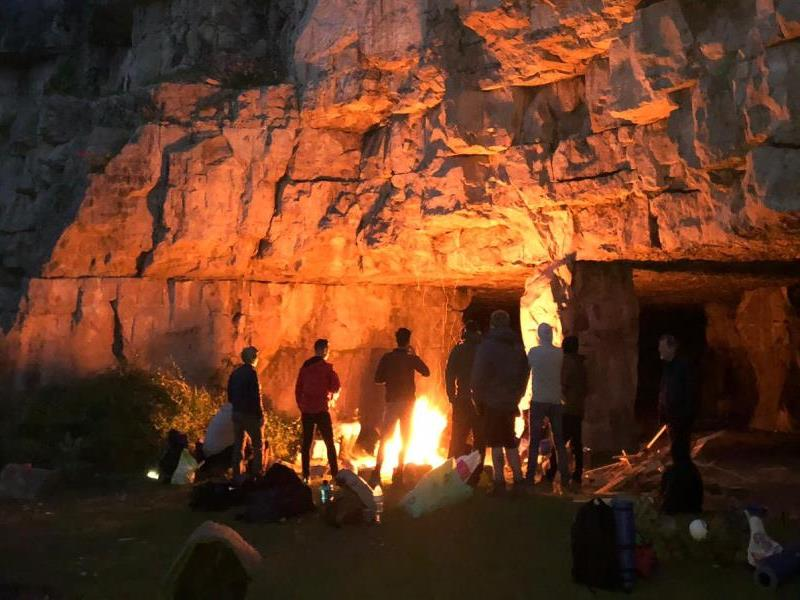 Camping in a cave is one of the coolest off-grid stag do choices