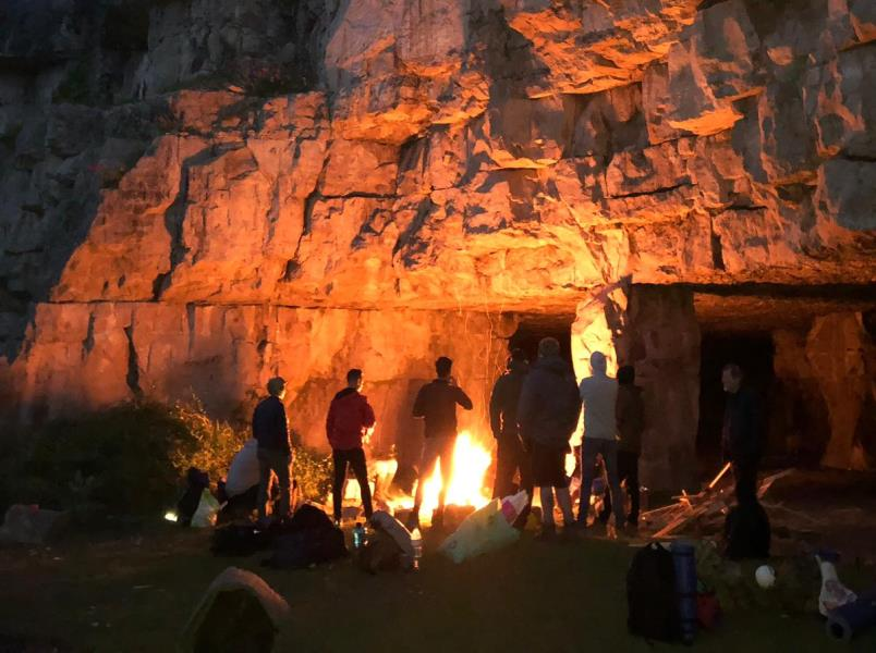 Cave camping near Bournemouth for an adventure stag do weekend